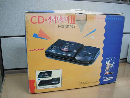 Consoles étranges , Machines méconnues ou jamais vues , du proto ou de l'info mais le tout en Photos - Page 11 Korean-Sega-CD-Aladdin-Boy-II-2-Samsung-Korea-Mega-Drive-Genesis-New-Super-1